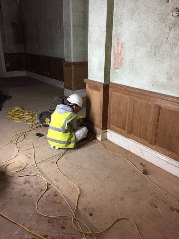 Beginning the snading process after paint stripping this quarter oak panelling