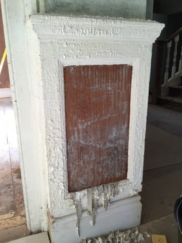 First panel stripped to find quarter oak under years of paint during the restoration of a Hampshire manor house