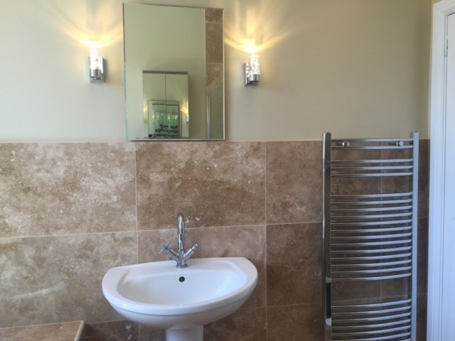 Bathroom refit with a low profile shower tray, full height glass shower screen, built in bath, and warm up underfloor heating. Floor and wall tiles are polished travertine
