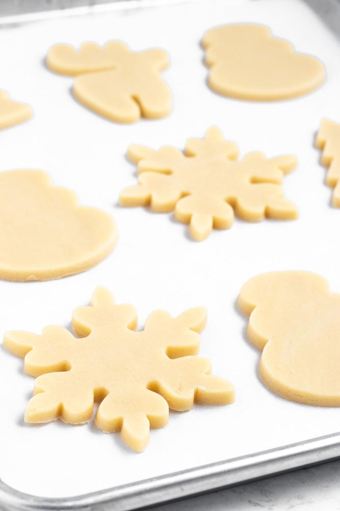 Prebaked cut out sugar cookies on sheet pan