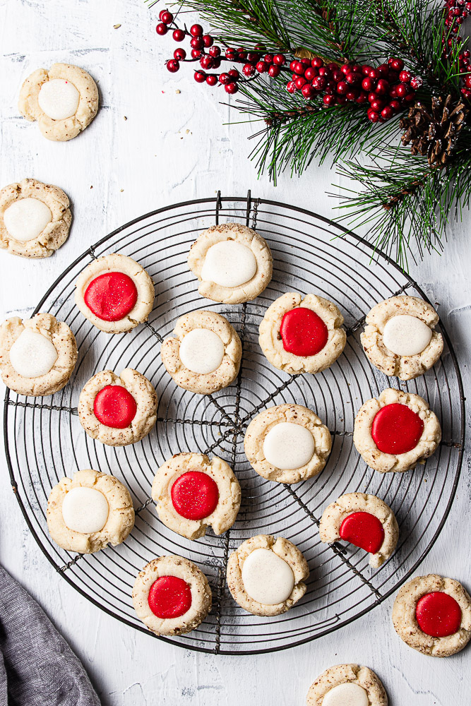 Red and White pecan thumbprint cookies on a vintage French cooling rack