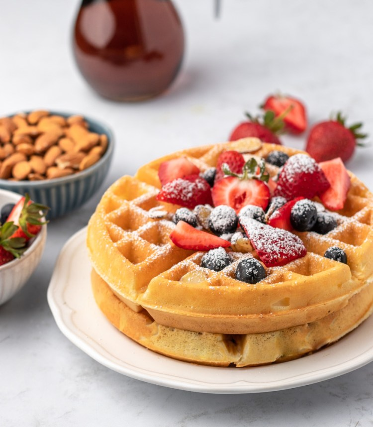 Belgian Waffles with Berries, almonds, and syrup