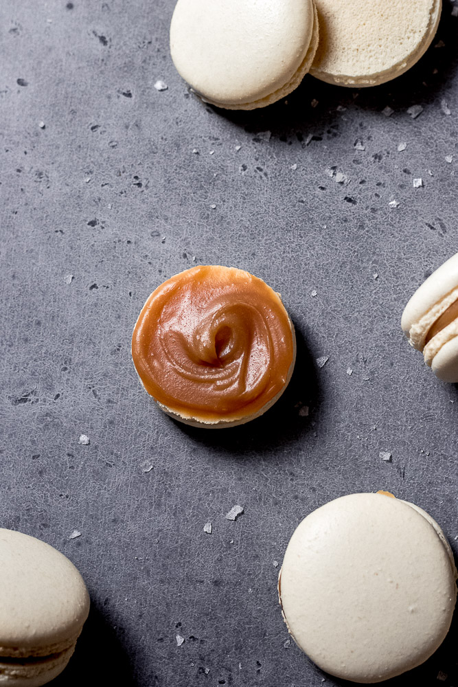 open salted caramel macaron showing caramel