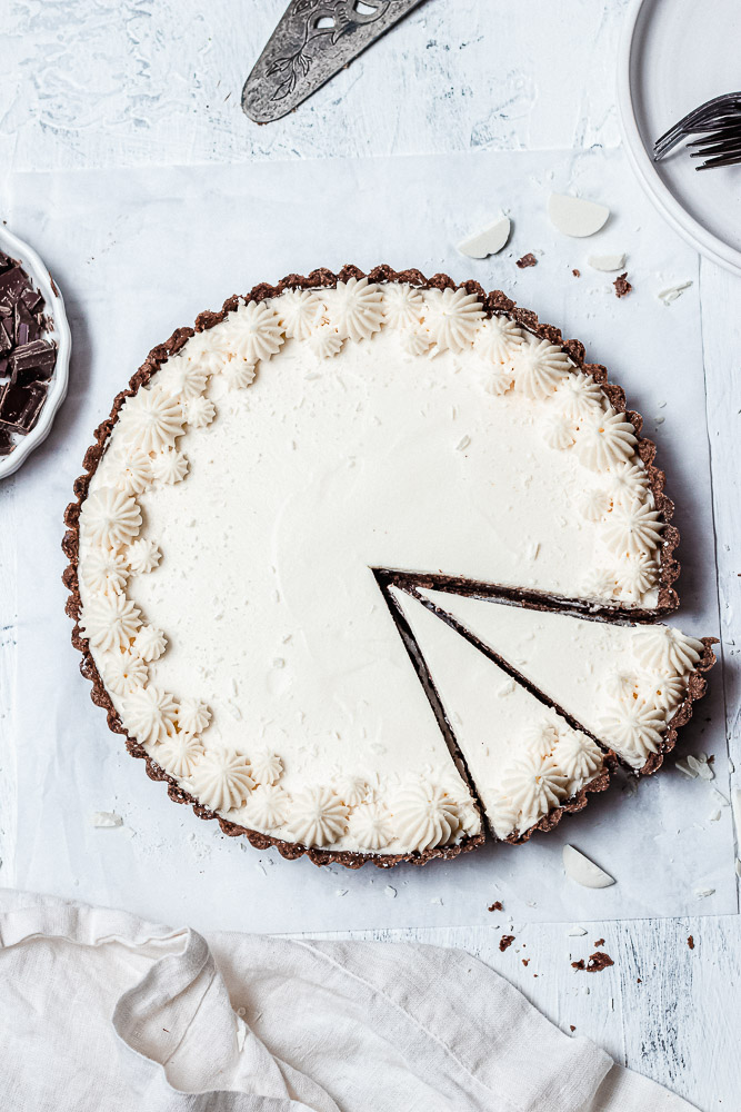 triple chocolate mousse tart with 2 slices cut