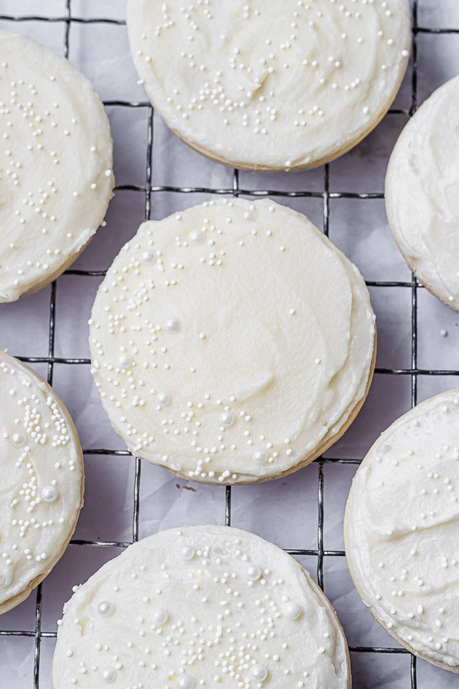white buttercream frosting on cookies