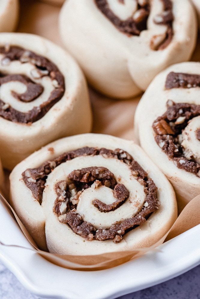 close up of unbaked pecan cinnamon rolls