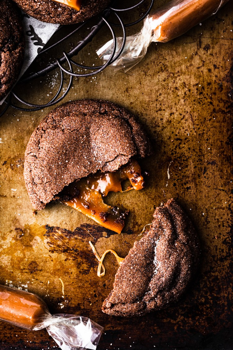 chocolate caramel cookie with caramel oozing out