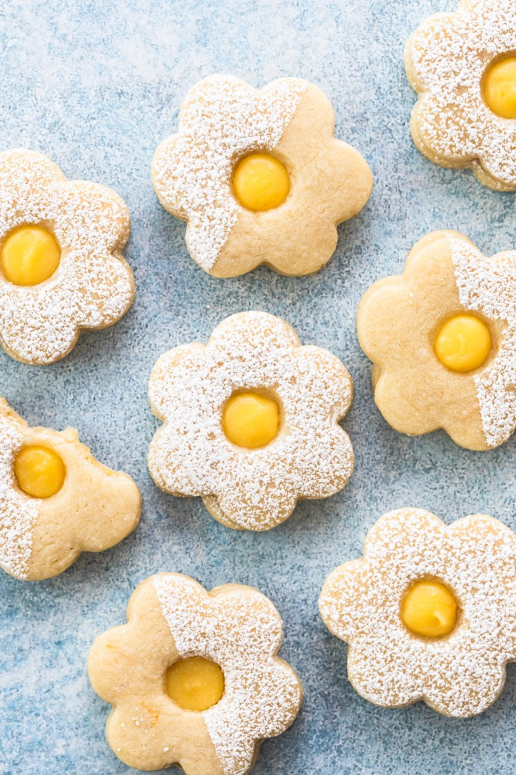 flatlay of meyer lemon linzer cookies dusted with powdered sugar