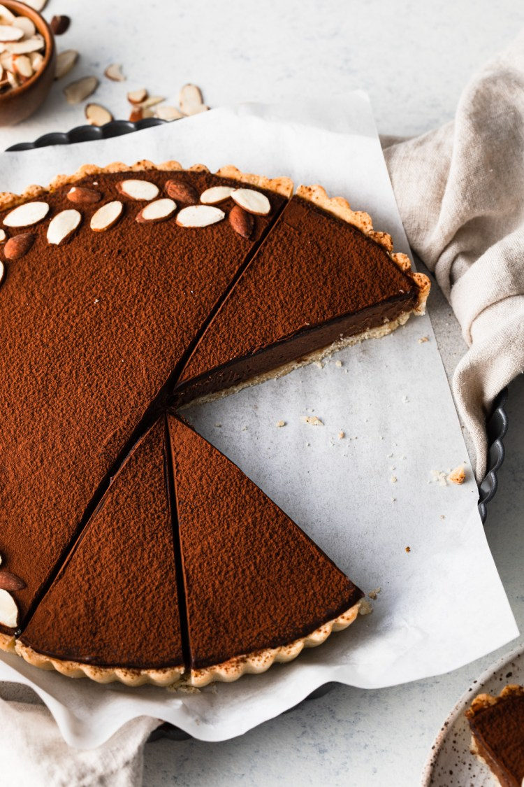 the top of a chocolate mousse tart with cocoa powder