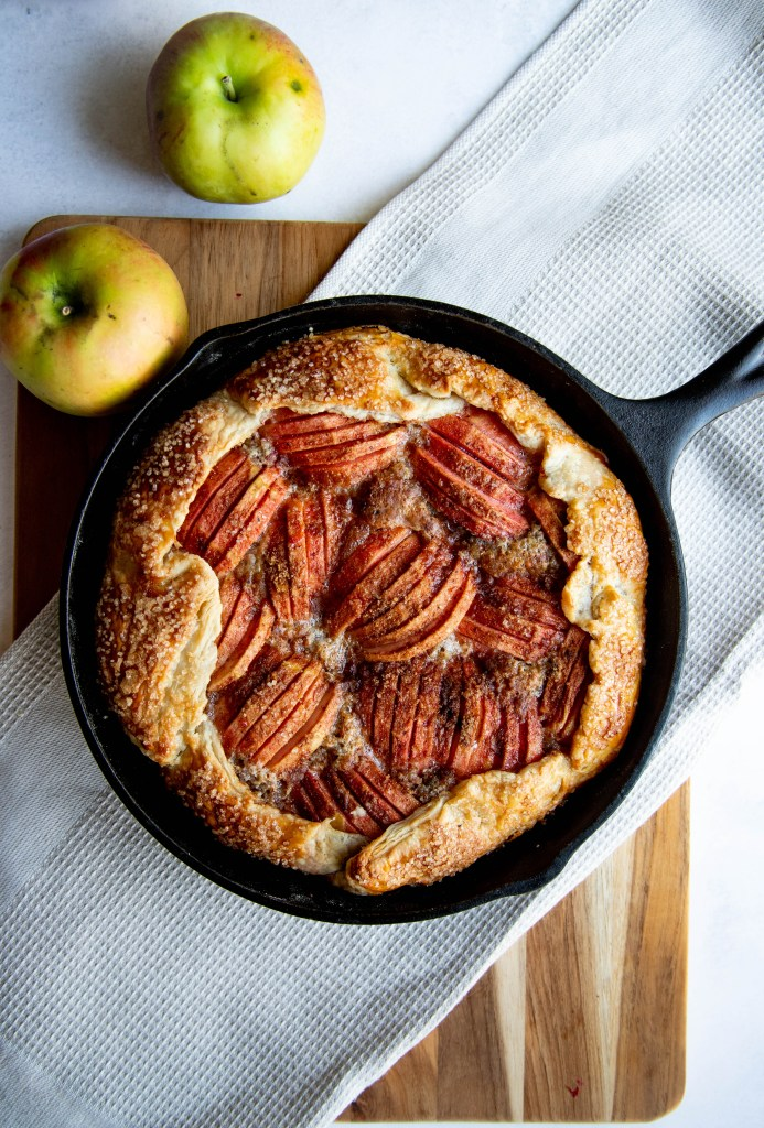 Apple Galette with Hazelnut Frangipane in Cast Iron Skillet with scarlet surprise apples