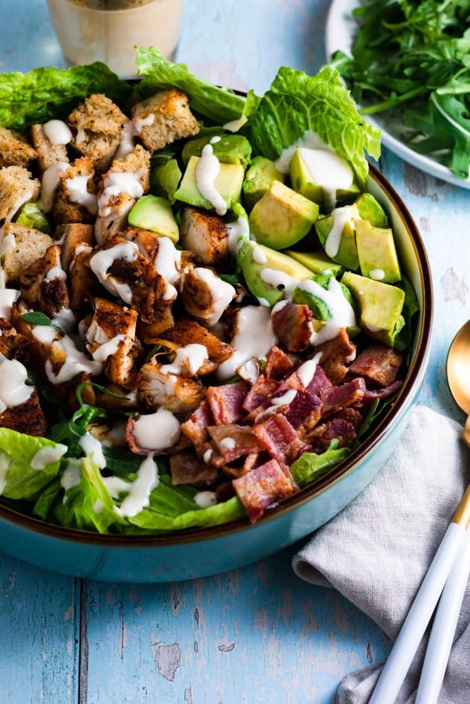 Warm Spiced Chicken and Avocado Bacon Caesar Salad