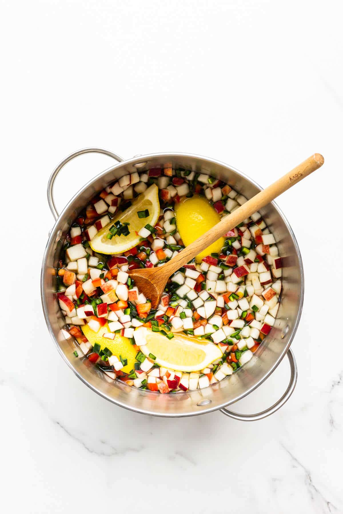 Ingredients for jalapeño jam combined in a big pot and ready to be cooked down on the stove.