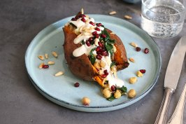 Sweet Potato with Chickpeas, Spinach and Tahini Sauce | Bake to the roots