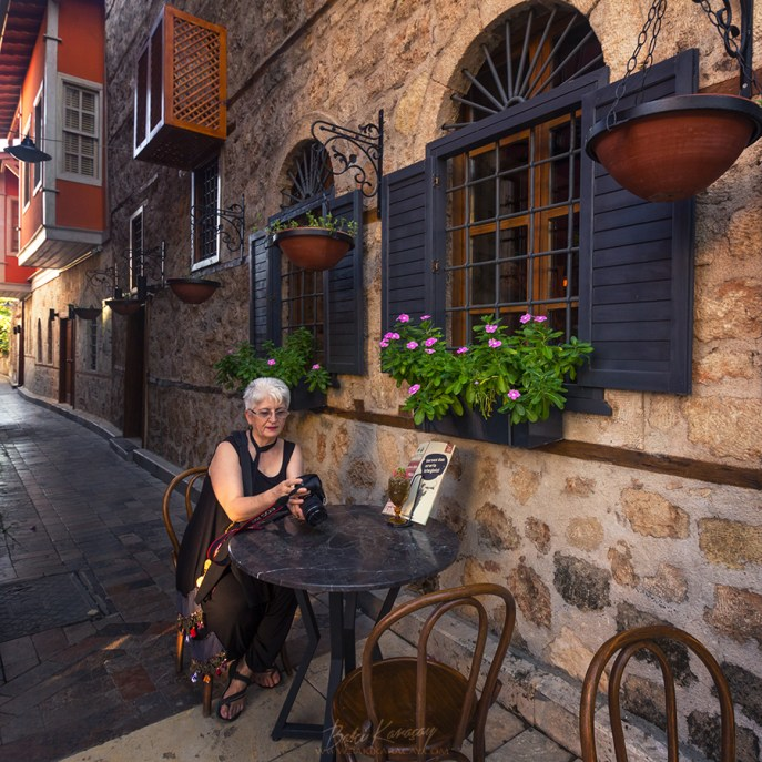 photographer-woman-sitting-authentic-house-old-city-antalya