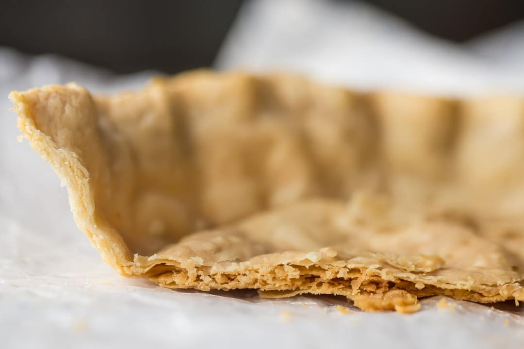 Close-up image of a flaky pie crust, showing many layers of crisp pastry.