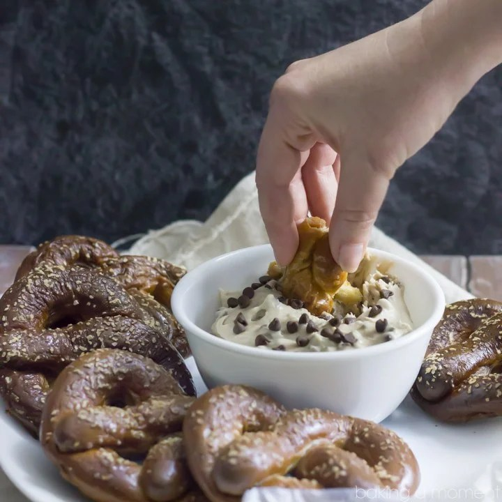 Homemade Soft Pretzels stuffed with Peanut Butter, served with a Malted Vanilla cream cheese Dip with Banana and Chocolate Chips.  These Chubby Hubby Pretzels and Dip are totally outrageous!  Perfect Superbowl dessert ;)