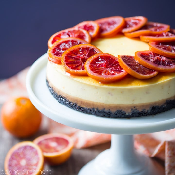 Blood Orange Cheesecake: the candied orange slices are so pretty and the citrus flavor works so well against the creamy cheesecake! The crunchy chocolate cookie crust is the perfect compliment. food desserts cheesecake