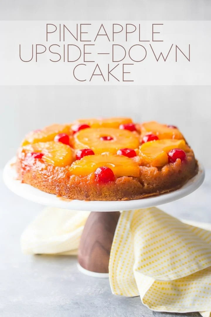 Vertical image with text overlay of a pineapple upside down cake on a white cake stand with a yellow napkin.