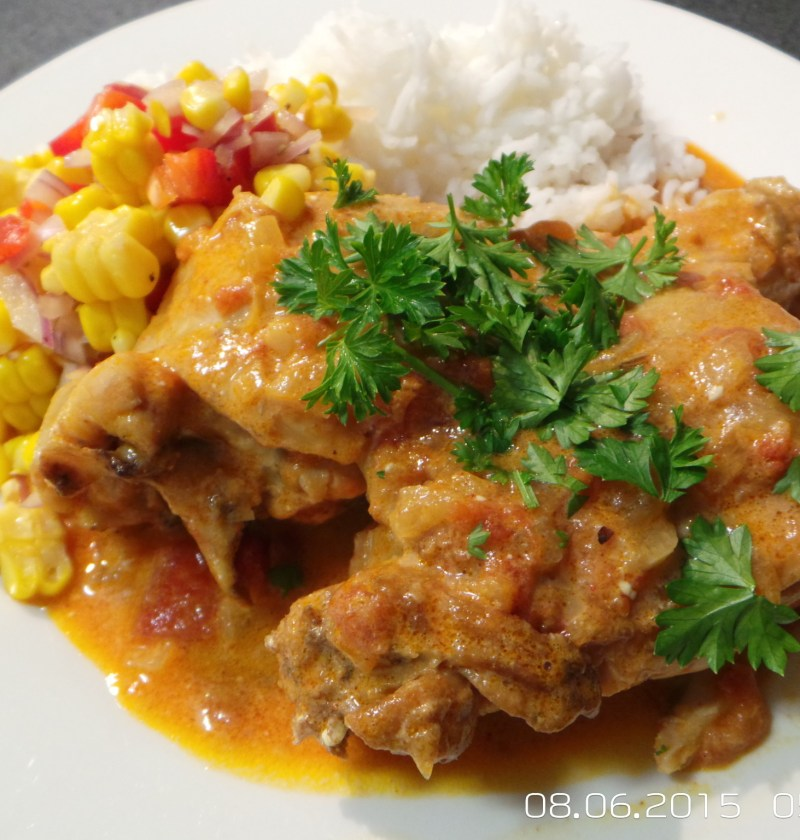 Paprika chicken with corn salsa and rice