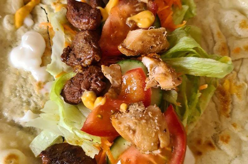 chorizo and chicken on a soft tortilla