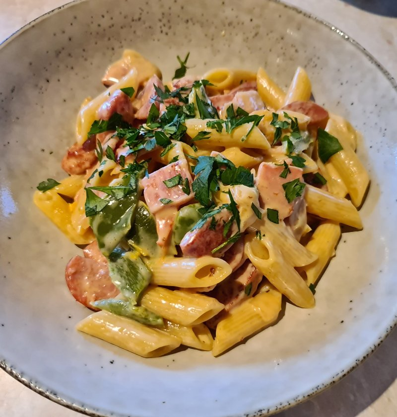Penne with kransky, bacon in a white wine sauce
