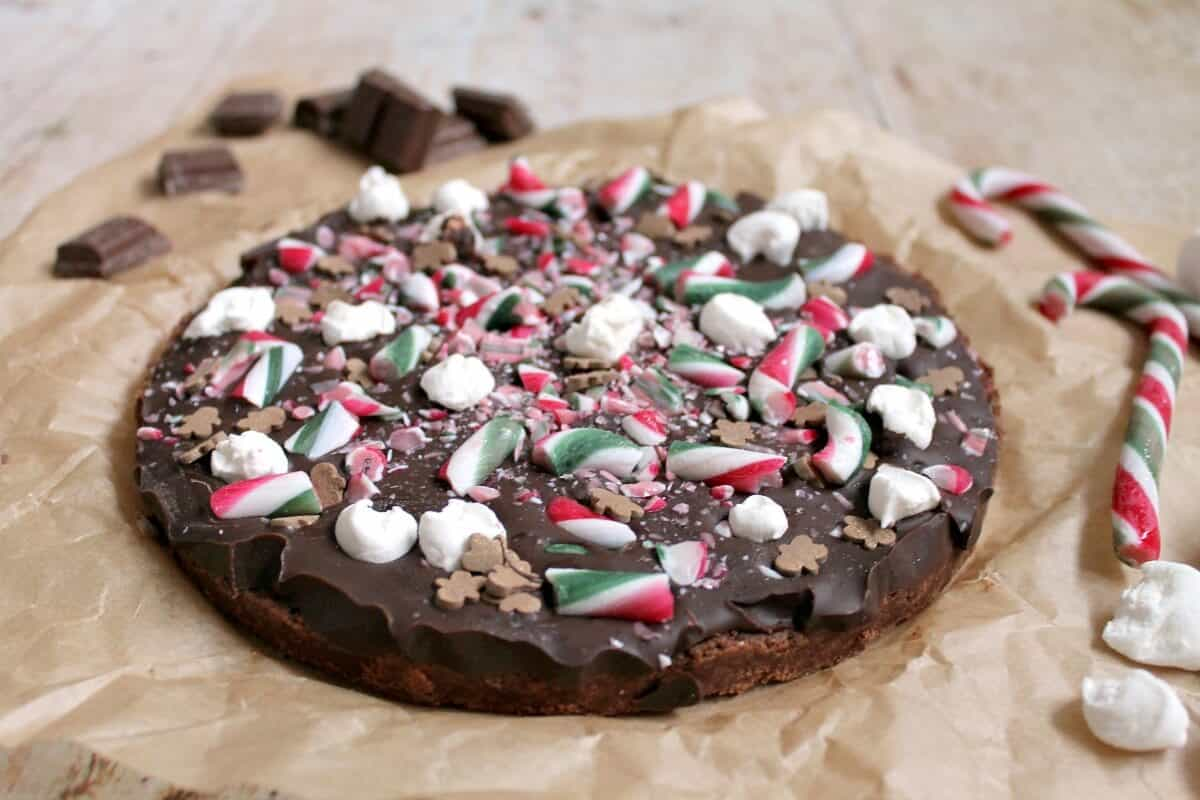 Christmas chocolate shortbread with candy canes, on baking paper