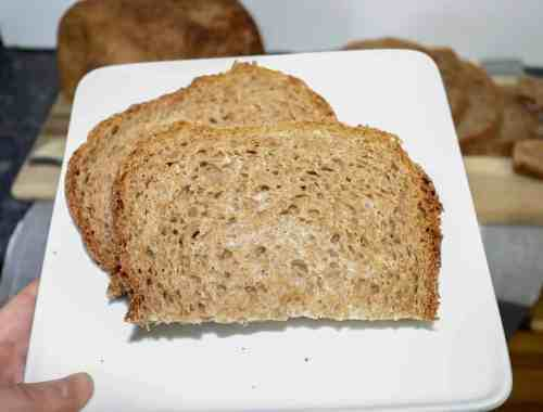 Whole wheat vegan bread shown on a white plate.