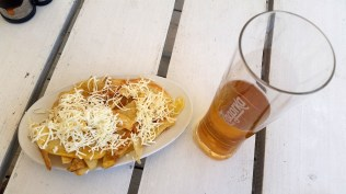 Beer and fries with feta cheese.... Simple pleasures :)