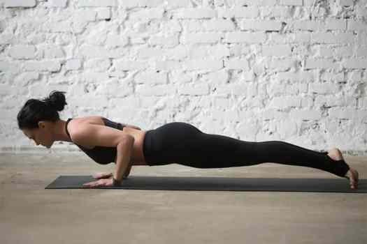 woman in chaturanga (or four-limbed staff pose)