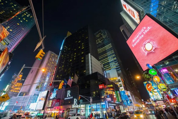 Picture of Time Square: Advertisement greatly contributes to society limiting our happiness