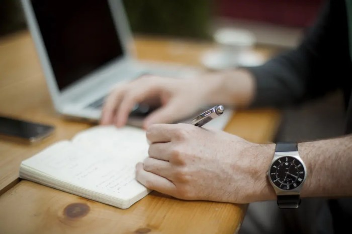 A man writes in his notebook to show how we can use various personal development tools to unify our personal development approach.