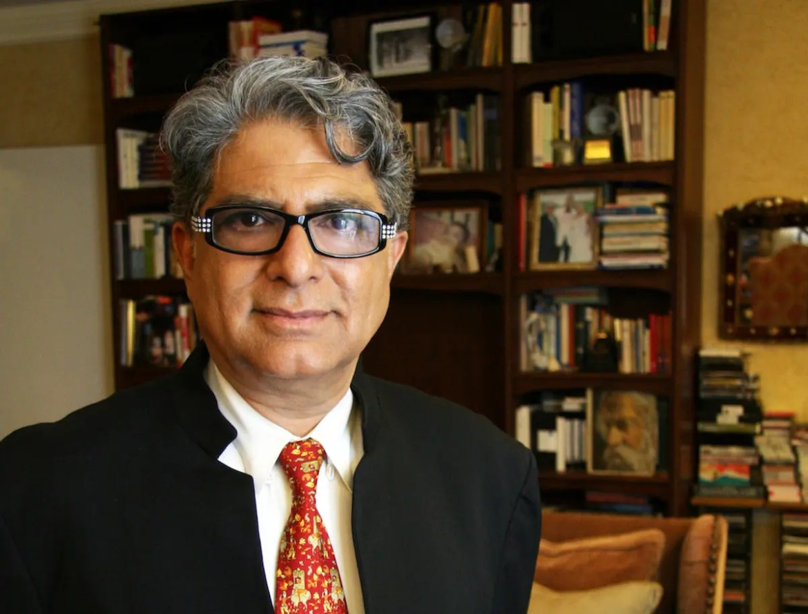Deepak Chopra is shown with a bookshelf in the background.