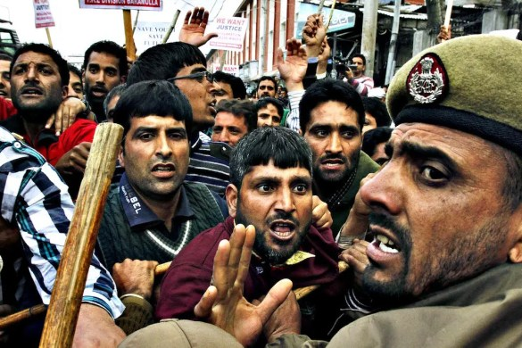 Protestors are show along with a government official in the Kashmir Conflict