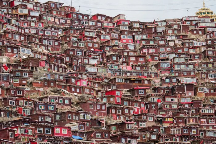 Larung Gar. Top view monastery at Larung gar (Buddhist Academy) in sunshine day, Sichuan, China). Image of housing at Larung Gar