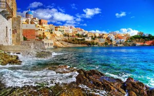 A picture of the colorful Ikarian coastline is shown. Ikaria is one of the five Blue Zones hotspots.