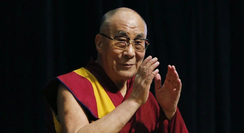 Tibetan spiritual leader the Dalai Lama greets an audience before his religious speech in Tokyo, Monday, Nov. 25, 2013.