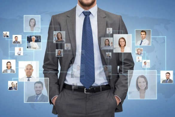 A close up of businessman with graphics showing pictures of people who are in his network. This picture represents the idea of social capital.