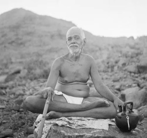 A picture of Ramana Maharshi in a meditation posture is shown.