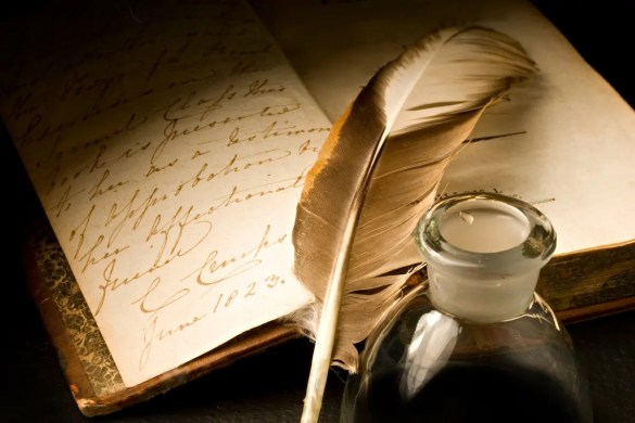 An old book is pictured with a feather pen and ink-pot. This picture represents the Ralph Waldo Emerson quotes featured in this quote 10 article.