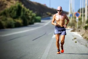 A middle age man, in decent shape, is shown running on a empty street. He has the goal to lose weight.