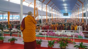 The Dalai Lama is shown waving to thousands of spiritual seekers and monks who visited Bodh Gaya for the 2017 Kalachakra Empowerment.