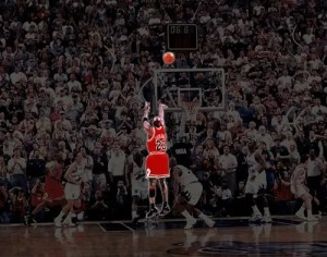 An image of Michael Jordan is shown hitting the game winning shot in the 1998 NBA Finals against the Utah Jazz.