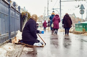An image shows a female beggar asking for money on a Moscow street. If individuals see us act compassionately to the poor, the natural reaction of moral elevation can motivate them to take similarly kind actions.