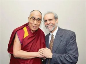 An image shows psychologist Daniel Goleman together with His Holiness the 14th Dalai Lama.