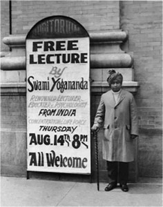 Paramahansa Yogananda is pictured standing next to a posture promoting one of his free lectures in America.