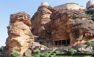 An image shows one of the four Badami Cave Temples in India.