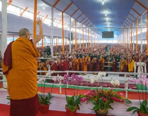 The Dalai Lama is shown speaking to a large crowd at the 2017 Kalachakra Empowerment.