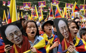 Tibetans living-in-exile shout slogans during a 'Tibet Solidarity Campaign' protest in New Delhi on November 6, 2013.