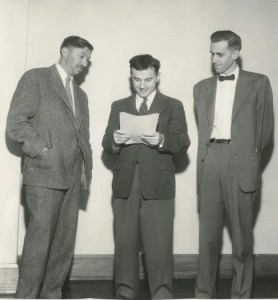 An image shows Abraham Maslow standing with two other eminent psychologists of his generation James Olds and David McClelland.