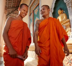 An image shows two Buddhist monks cheerfully talking to one another. This image represents the Division of Moral Discipline in the Buddha's Noble Eightfold Path.